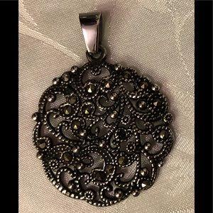 Jewelry - Beautiful Black round Pendant with swirl design.